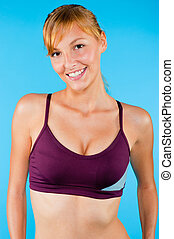 Toned Woman in Sportswear - An attractive toned woman posing...