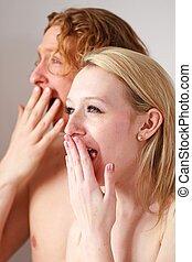yawning couple