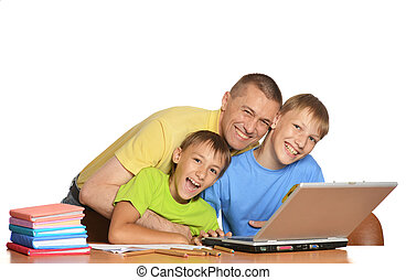 Boys doing homework with father - Father is helping his kids...