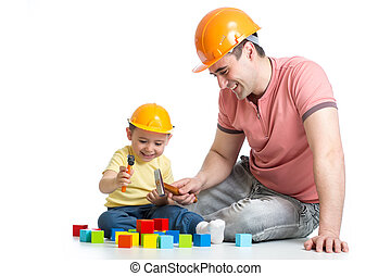 kid and his dad play with building blocks