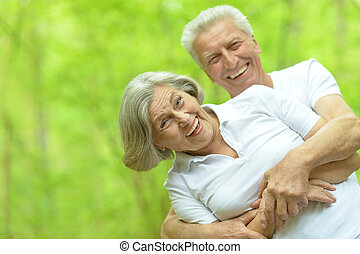 Senior couple walking - Happy smiling elderly couple walking...