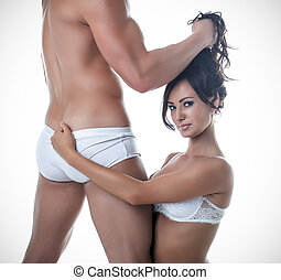 Image of young sensual lovers posing at camera, isolated on...