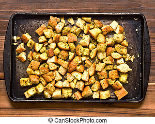 crouton - close up of a tray of rustic homemade baked...