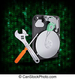HDD with magnifying glass and adjustable wrench - Abstract...