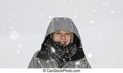 Young Woman in heavy Snow
