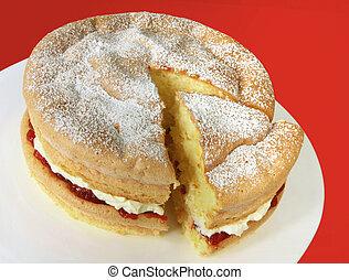 Sponge Cake - Home-baked sponge cake filled with fresh...