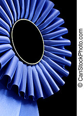 Blue Rosette - Blue rosette, in closeup, against black...