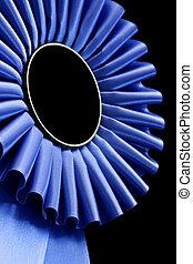 Blue Rosette - Blue rosette, in closeup, against black...