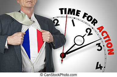 Businessman showing superhero suit with flag from French...