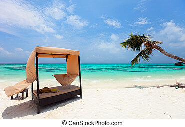 Idyllic tropical beach at Maldives - Day bed cabana on a...