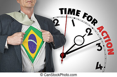Businessman showing superhero suit with flag from Brazil...