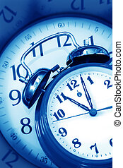 Time clocks, combined in blue toned image