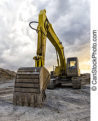 Backhoe - Yellow excavator loader machine at construction...