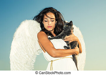angel and cat - beautiful angel woman against sky with cat...