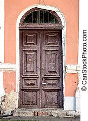 Old weathered wooden main door.