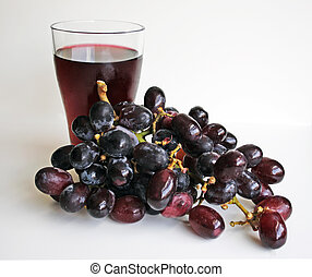 Grape juice and grapes - A cluster of freshly washed grapes...