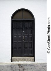 Spanish Black Door - Black wooden door of a typical Spanish...