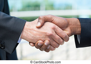 Business handshake Close-up of business men shaking hands
