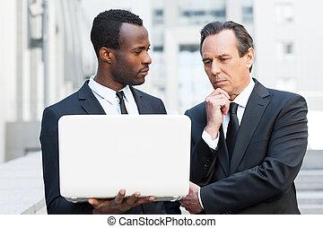 He needs an expert advice. Two confident business men...