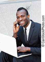 Living a business life Cheerful young African man in...
