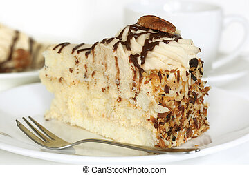 Pecan Cake - Pecan cream sponge cake, with a cup of coffee.