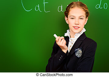 english lesson - Smiling schoolgirl performs the task at the...