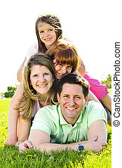 Happy family - Portrait of happy family of four laying on...