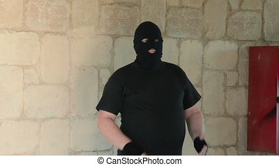 Bandit ambushing with knife - Bandit in balaclava ambushing...