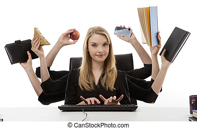 busy woman at her desk - busy business woman multitasking in...