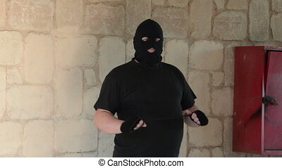 Bandit ambushing with noose - Bandit in balaclava ambushing...