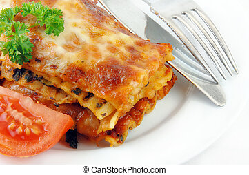 Lasagna and Tomatoes on White - Lasagna and tomatoes with...