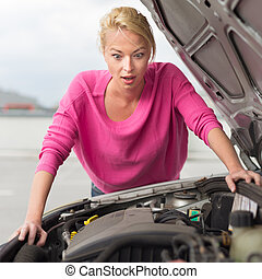 Stressed Young Woman with Car Defect Engine breakdown