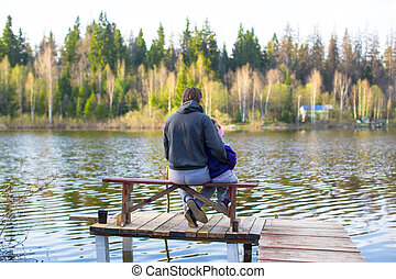Young dad and little girl fishing on the lake - Young father...