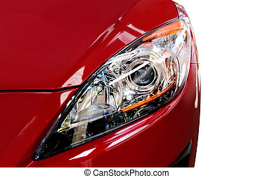 Red Car Detail - Headlight of modern red car, isolated on...