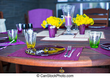 Beautiful home served table for dinner on the veranda -...