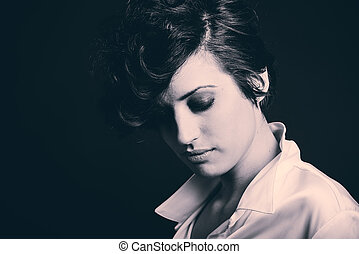 Woman with intense look on black background
