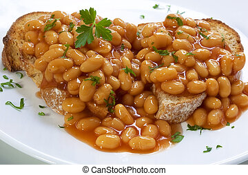 Baked Beans - Baked beans on sourdough toast, garnished with...