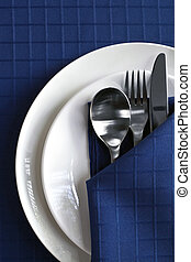 Place Setting - Place setting with plates, silverware, and...