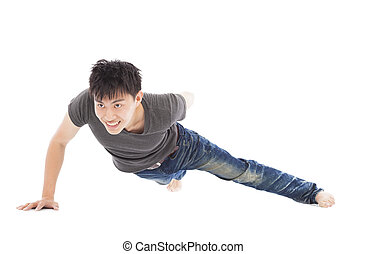 confident young man make push-ups by single hand