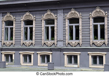 Windows of the house of merchants Chiralov. Architectural...