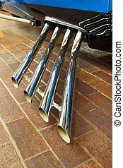 racing exhausts - chrome exhaust pipes on a performance race...