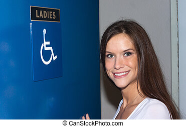 Attractive Woman Enters Ladies Bathroom Women's Handicapped...