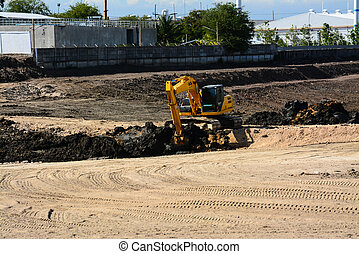 Wheel loader Excavator loading soil at eathmoving works in...