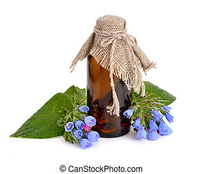 Symphytum (comfrey) with pharmaceutical bottle