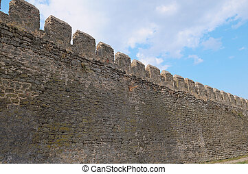 Wall of fortress - ancient fortress wall and blue sky