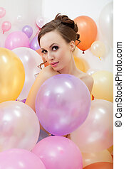 Attractive nude girl posing with colorful balloons - Image...