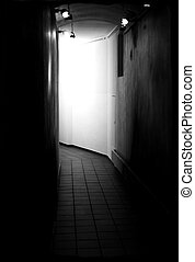 Dark passage - The photograph of a dark corridor with...