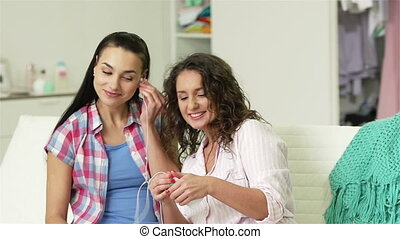 Music Lovers - Pretty girls listening to music and imitating...