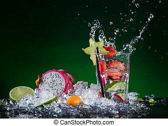 Fresh fruit cocktail in freeze motion splashing