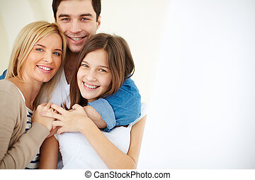 Affection and love - Portrait of joyful family looking at...